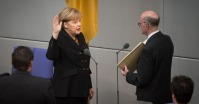 Angela Merkel being sworn in as Federal Chancellor. Photo: Bundesregierung/Steins